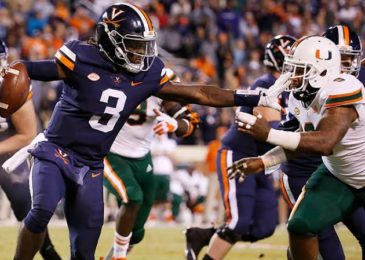 Virginia star DB Bryce Hall hauled away the field with leg injury suffered in first half versus Miami