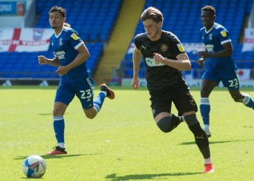 Wigan Athletic star left back Tom Pearce linked with a move to the EPL