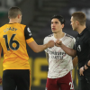 Hector Bellerin sends cryptic message to referee Craig Pawson on social media as Arsenal stars fume over David Luiz dismissal following Wolves defeat