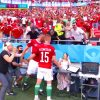 Hungary's Attila Fiola smashes up reporter's desk in celebration after scoring towards France at Euro 2020